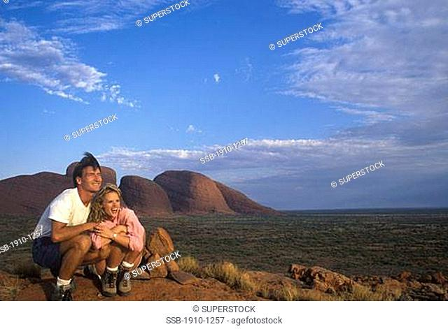 Couple Hikers on hill above the Olgas Uluru-Kata Tjuta National Park Red Center AUSTRALIA Northern Territory