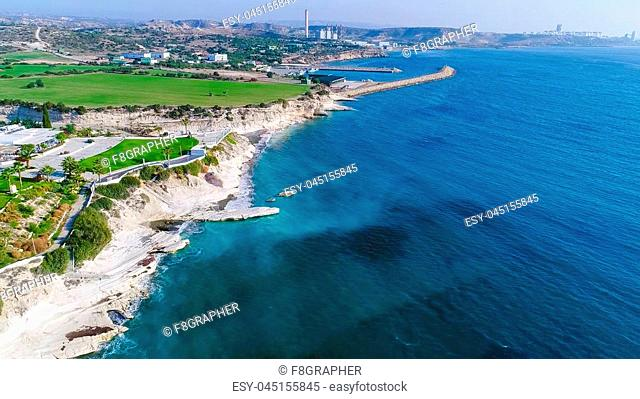 Aerial view of coastline and landmark big white chalk rock at Governor's beach, Limassol, Cyprus. The steep stone cliffs and deep blue sea waves crushing in...