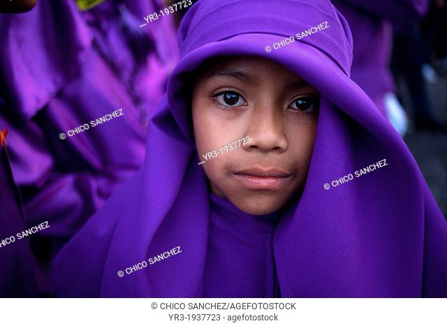 A boy dressed as a penitent participates in the Jesus Nazareno del Perdon procession during Easter Holy Week in Antigua Guatemala, Guatemala, March 28, 2013