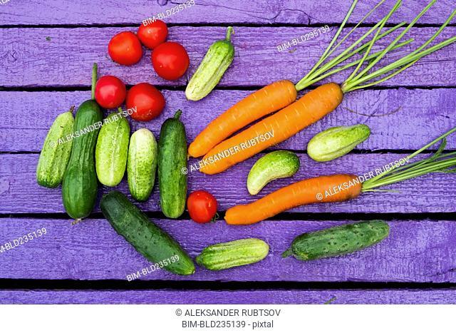 Fresh vegetables on purple wooden table