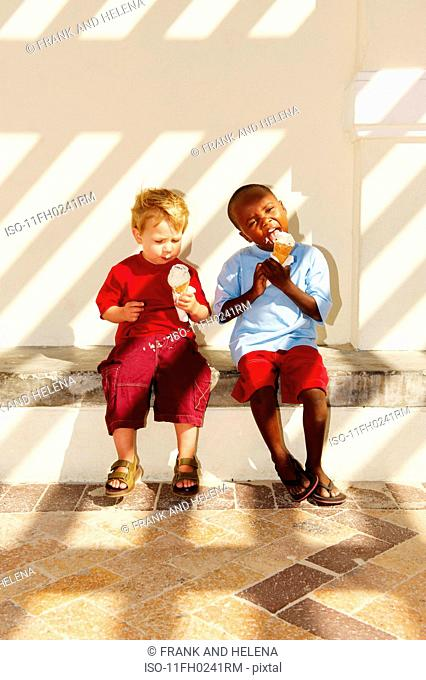 Young boys eating ice cream
