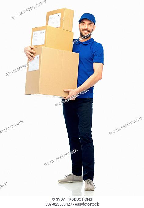 delivery service, mail, people, logistics and shipping concept - happy man with parcel boxes