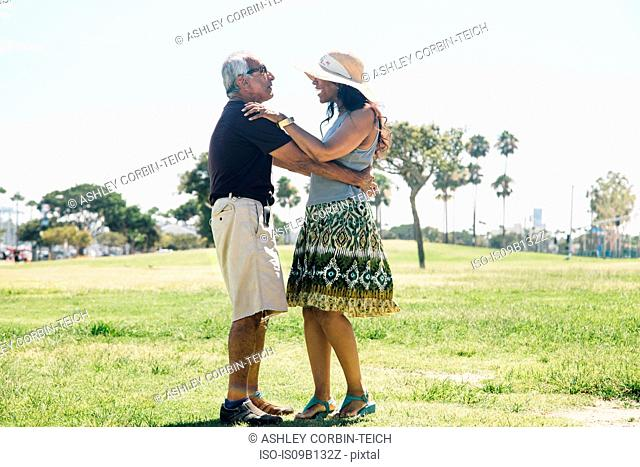 Senior couple dancing outdoors, Long Beach, California, USA