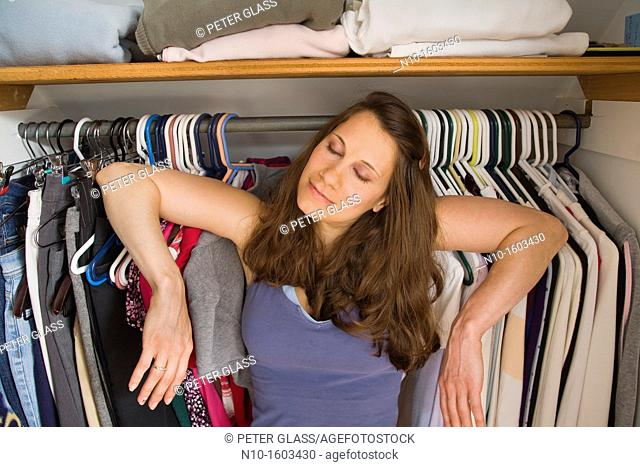 Young woman standing inside her closet