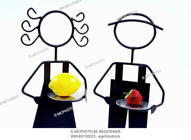 symbolic for man and woman with citron and strawberry