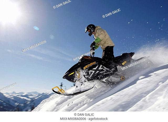 Man on snowmobile, Whistler, British Columbia, Canada