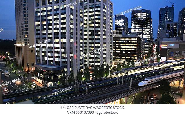 Japan-Tokyo City-Ginza District- The Bullet train through Yurakucho area at sunset