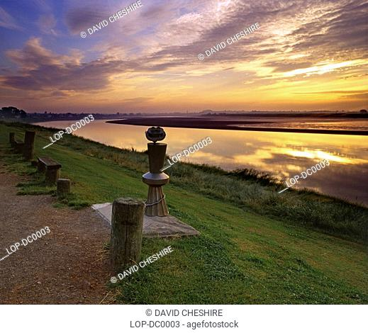 England, Gloucestershire, Newnham-on-Severn, A dawn sky reflects in the water of the River Severn
