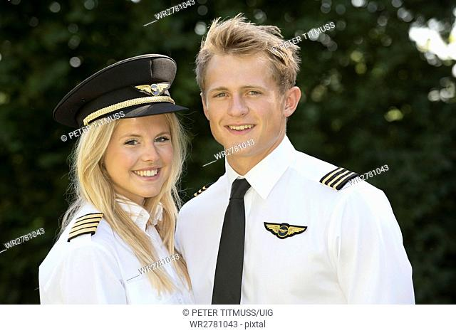 Portrait of two young airline officers