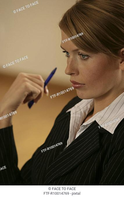 A side view of a blonde businesswoman looking over her laptop