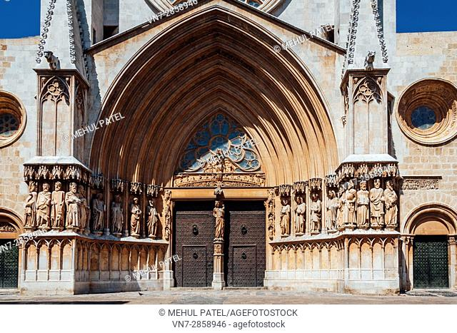 Front on view of main gate and facade of the Cathedral of Tarragona, Catalonia, Spain. The cathedral is situated in the old town of Tarragona at the city's...