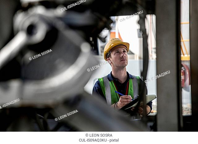 Male worker doing inspection at fuel depot