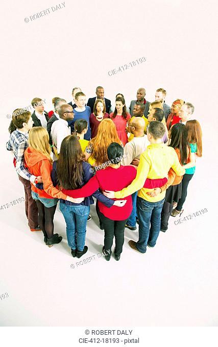 Diverse group forming huddle