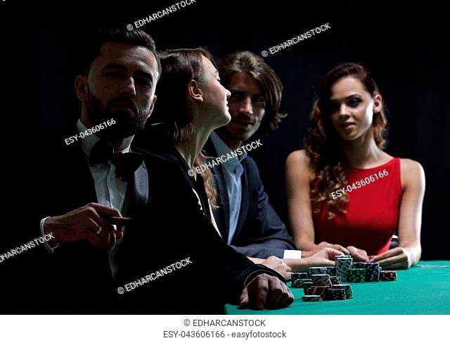 Well-dressed group at poker table