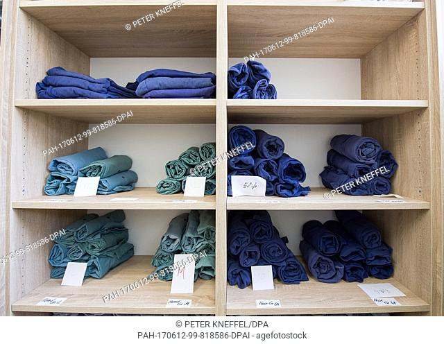 Inmate clothing in several different sizes can be seen at the Deportation Detention Centre in Eichstaett, Germany, 12 June 2017 Photo: Peter Kneffel/dpa