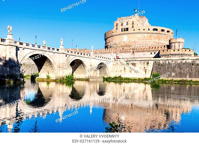 travel to Italy - scenery with Castel Sant Angelo (Castle of the Holy Angel, Mausoleum of Hadrian) and bridge of St Angel in Rome city from Tiber river in sunny...