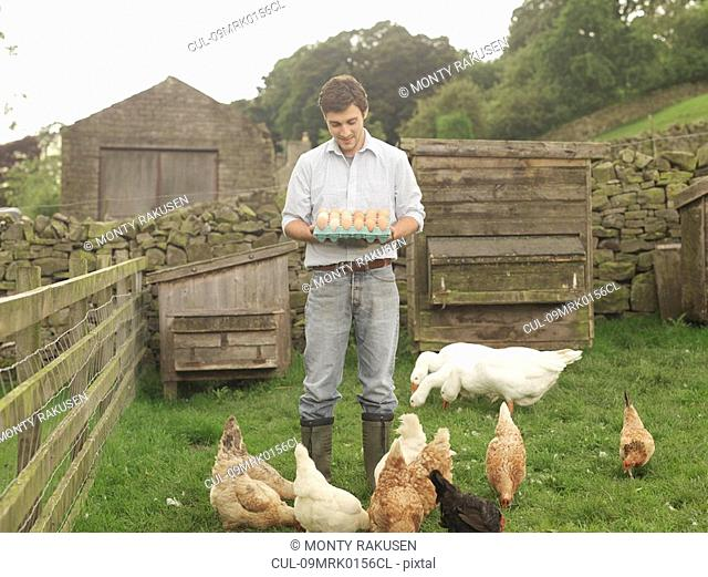 Farmer With Eggs, Hens And Geese