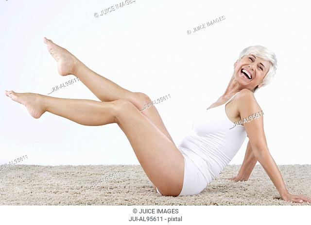 Happy senior woman in undergarments, portrait