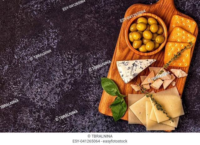 Cheese cracker olives wine. Top view with copy space
