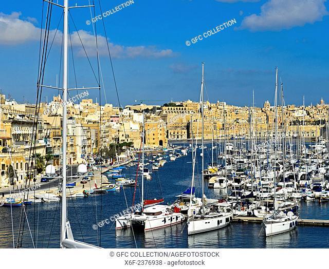 Boats moored in the Vittorioso marina, view towards Valletta, Malta