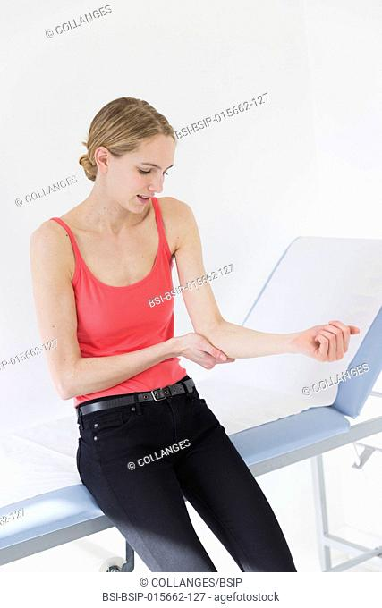 Female patient consulting for elbow pain
