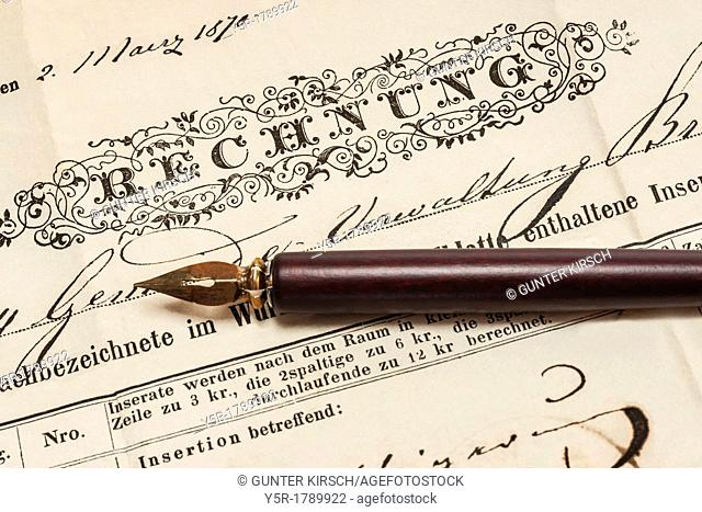 Detail photo of a old German invoice from the year 1870, a fountain pen is alongside