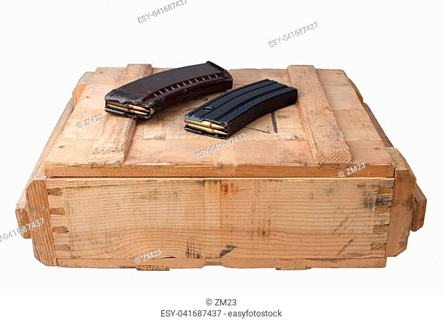 m16 and ak47 magazins on wooden box isolated