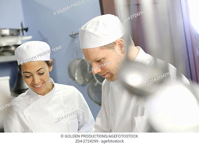 Man and woman working in restaurant kitchen