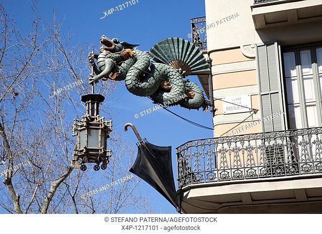 Gragon and umbrella above a former umbrella shop along the Rambla. Barcelona, Spain
