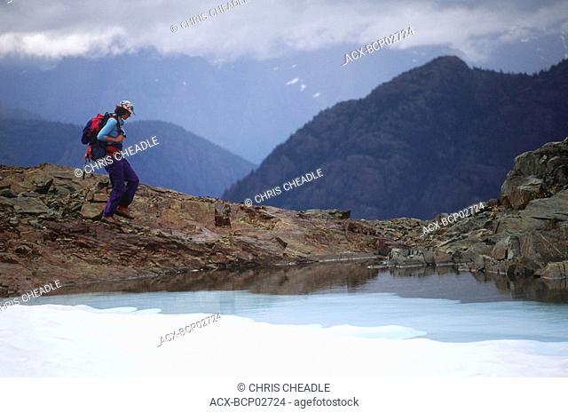 Strathcona Provincial Park, hiker on Mt Albert Edward descent, Vancouver Island, British Columbia, Canada