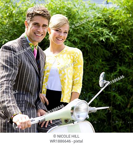 young couple on a classic motor scooter