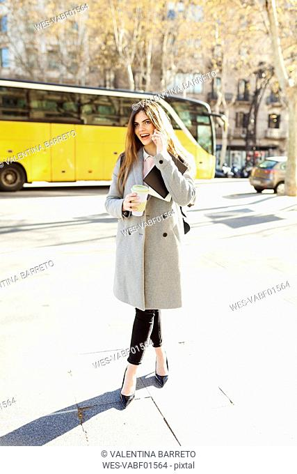 Spain, Barcelona, young businesswoman on the phone