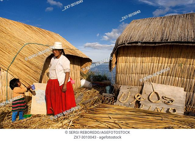 Uros Island, Lake Titicaca, peru, South America. A woman and her daughter on an island of the Uros. These islands are built on a dense totora vegetation