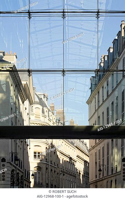 Traditional Paris apartment buildings and reflection of modern glass roof in Paris, France. Looking down Passage des Jacobins and out into rue du Marche...