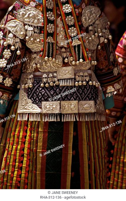 Detail of silver ornaments on festival dress of a Miao woman, Langde, Guizhou province, China, Asia