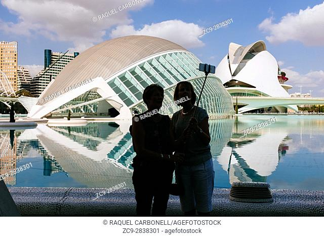 Tourists around the Hemisferic building. The Hemisfèric was inaugurated in 1998 and was the first building in the City of Arts and Sciences to open its doors to...