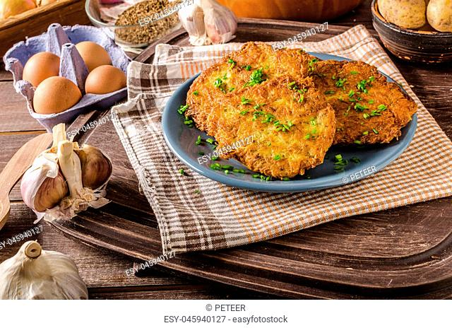 Potato pancakes fried, full of garlic, herbs