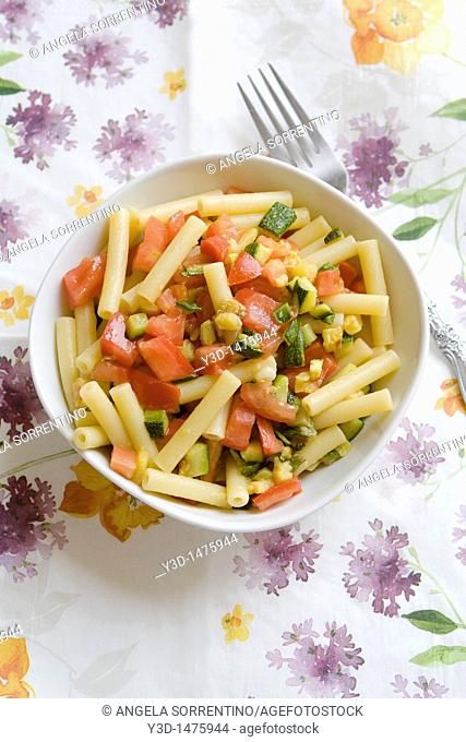 Pasta salad with zucchini and tomatoes Italy