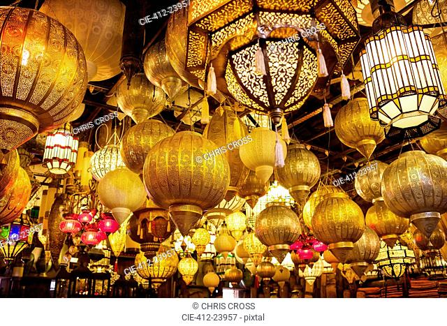 Low angle view of various illuminated lamps in market