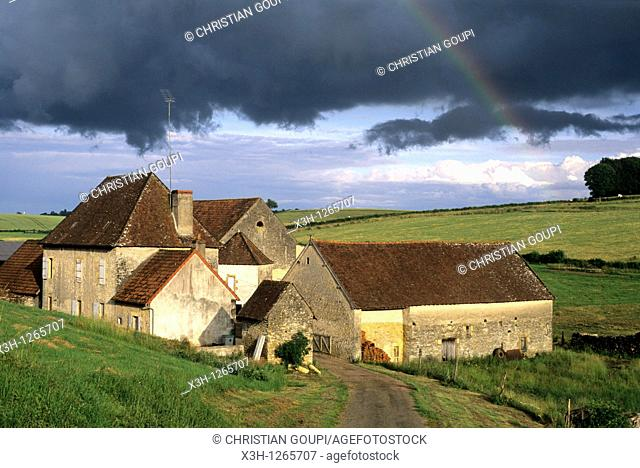 farmhouse under stormy sky, around Nevers, Nievre department, region of Burgundy, center of France, Europe