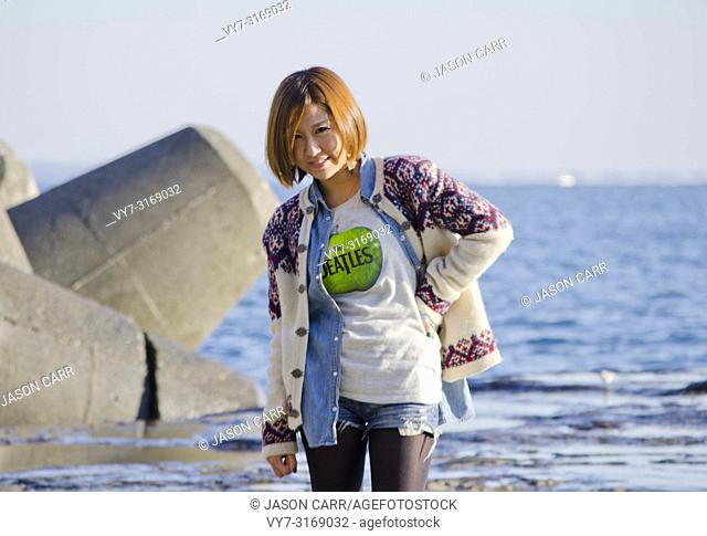 Japanese Girl poses in Enoshima, Japan. Enoshima is an area where is famous about the beach