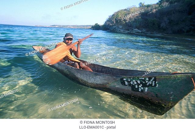 Fisherman in Dugout Canoe Coming in to Shore  Nacala Bay, Northern Mozambique