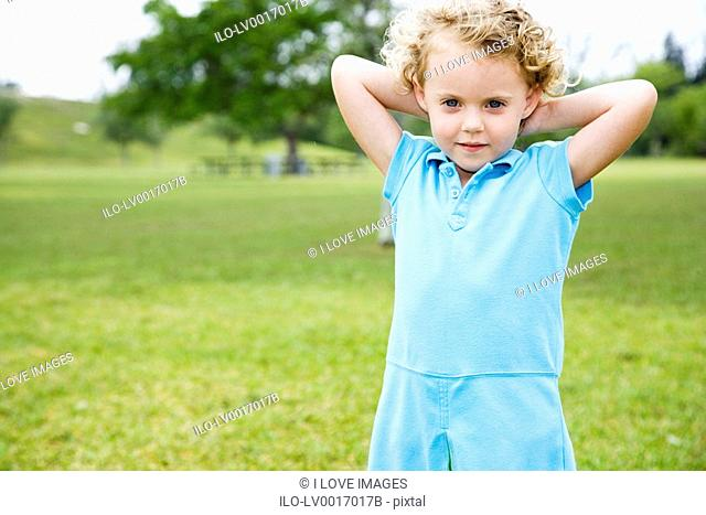 Little girl standing in the park