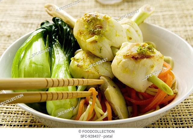 Scallop kebab with pak choi and egg noodles Asia