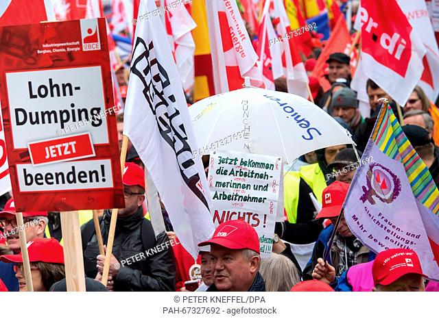 Several hundred demonstrators carry flags and signs at the DGB (Confederation of German Trade Unions) rally against the abuse of contract work and special-order...