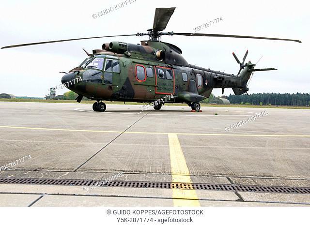 Gilze-Rijen, Netherlands. Military Cougar helicopter parked at an airbase platform