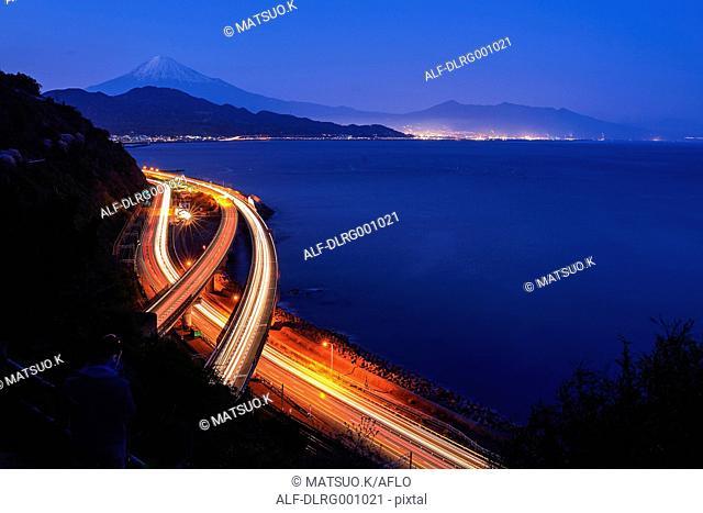 Night view of Mount Fuji and highway from Satta ridge at sunset, Shizuoka Prefecture, Japan