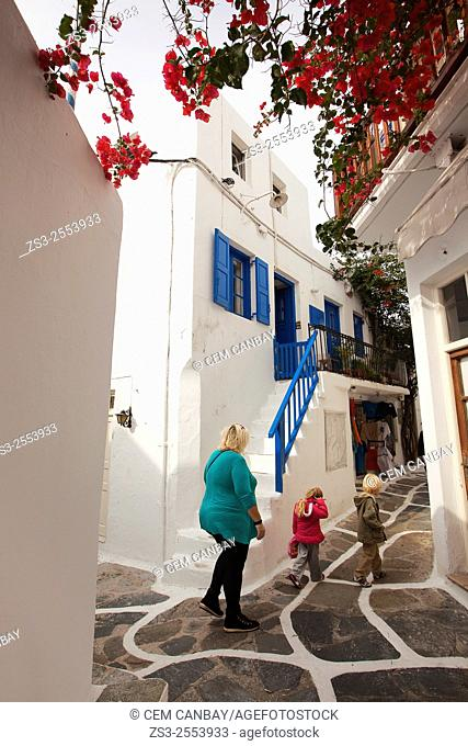 Tourists walking through the narrow streets in town center, Mykonos, Cyclades Islands, Greek Islands, Greece, Europe