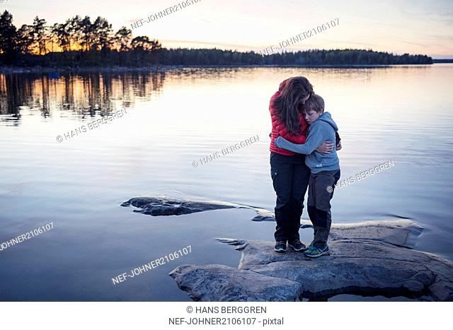 Mother with son at water
