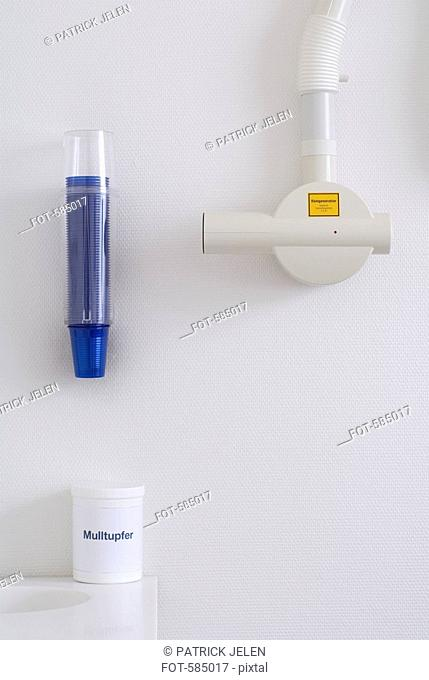 Dental Intraoral X-ray system with plastic drinking cup dispenser and jar of swabs